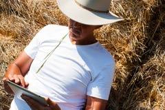 Cowboy using tablet computer horizontal Royalty Free Stock Photos