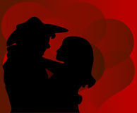 Cowboy Valentine. Two lovers on a background of hearts Royalty Free Stock Images