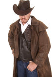 Cowboy in vest and duster hat cover eyes look down Royalty Free Stock Photo