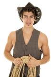 Cowboy in vest met kabel in handen stock fotografie
