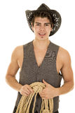 Cowboy in vest with rope in hands Stock Photography