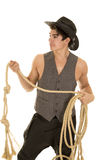 Cowboy in vest with rope look side Royalty Free Stock Photos
