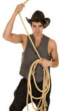 Cowboy in vest with rope over head Royalty Free Stock Images