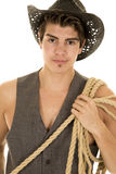 Cowboy in vest with rope on shoulder close Royalty Free Stock Photography