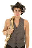 Cowboy in vest with rope on shoulder Royalty Free Stock Images