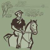 Cowboy vivant en troupe des moutons Images stock