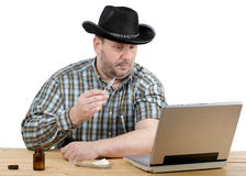 Cowboy watching manual how to give an self-injection Royalty Free Stock Photo