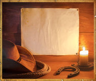 Cowboy western background for text. American rodeo cowboy background with western hat and lasso for text Stock Photo