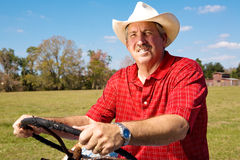 Cowboy at the Wheel Royalty Free Stock Photos