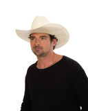 Cowboy in a white hat and black shirt Stock Image