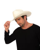 Cowboy in a white hat and black shirt Royalty Free Stock Images