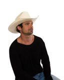 Cowboy in a white hat and black shirt Royalty Free Stock Image