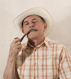 Cowboy in white hat with Pipe Stock Photo