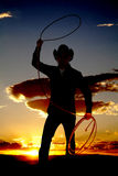 Cowboy With Rope In Air Sunset Stock Photo