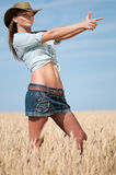 Cowboy woman in country wheat field Royalty Free Stock Photos