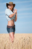Cowboy woman in country wheat field Royalty Free Stock Images