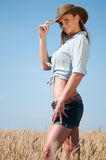 Cowboy woman in country wheat field Royalty Free Stock Photography