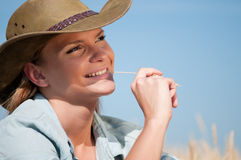 Cowboy woman in country wheat field Royalty Free Stock Image