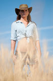 Cowboy woman in country wheat field Stock Photos