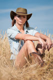 Cowboy woman in country wheat field Stock Images