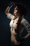 Cowboy woman. Girl cowboy hat on a gray background Royalty Free Stock Images