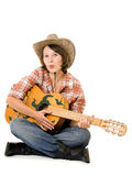 Cowboy woman with a guitar. Royalty Free Stock Photography
