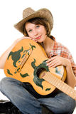 Cowboy woman with a guitar. Royalty Free Stock Image