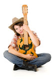 Cowboy woman with a guitar. Stock Image