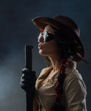 Cowboy woman. With a gun in his hand Royalty Free Stock Photo