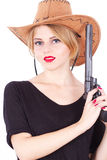 Cowboy woman holding a big gun Royalty Free Stock Image