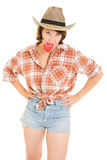 Cowboy woman holding a red heart in his teeth Royalty Free Stock Image