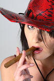 Cowboy woman smoking cigar Royalty Free Stock Images