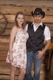Cowboy and woman stand together looking Royalty Free Stock Images