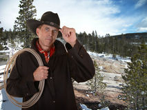 Cowboy working outside in winter Stock Photo