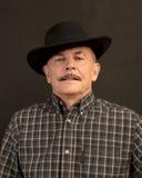 Cowboy in zwarte hoed Stock Foto's