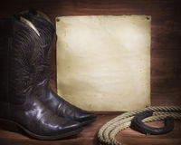 Cowboyachtergrond met westelijke schoenen en lasso en document Royalty-vrije Stock Afbeelding