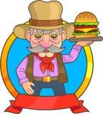 Cowboyen behandlar den smakliga hamburgaren Royaltyfri Bild