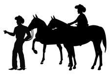 Cowboyer i kontur Arkivbild