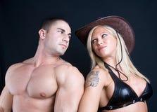 Cowboyflicka och pojke royaltyfri fotografi