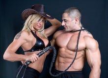 Cowboyflicka och pojke fotografering för bildbyråer