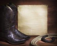 Cowboyhintergrund mit Westschuhen und Lasso und Papier Lizenzfreies Stockbild