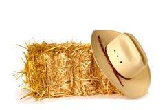 Cowboyhut- und Strohballen Stockbild
