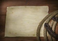 Cowboylasso och hästsko Arkivfoton