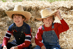 Cowboys. Two Young Cowboys Relax in the Hay royalty free stock images