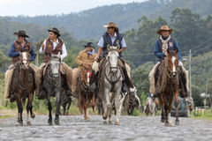 Cowboys arriving on horse back to a rural rodeo Stock Photography