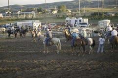 Cowboys au rodéo de PRCA Photographie stock libre de droits