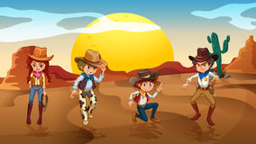 Cowboys and a cowgirl at the desert Royalty Free Stock Images