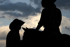 Cowboys dans le grand pays de ciel Photographie stock