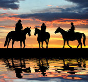 Cowboys de silhouette Photographie stock