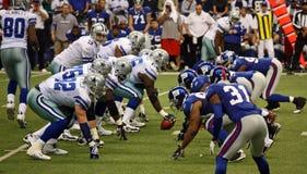 Cowboys e formação de Giants fotografia de stock royalty free